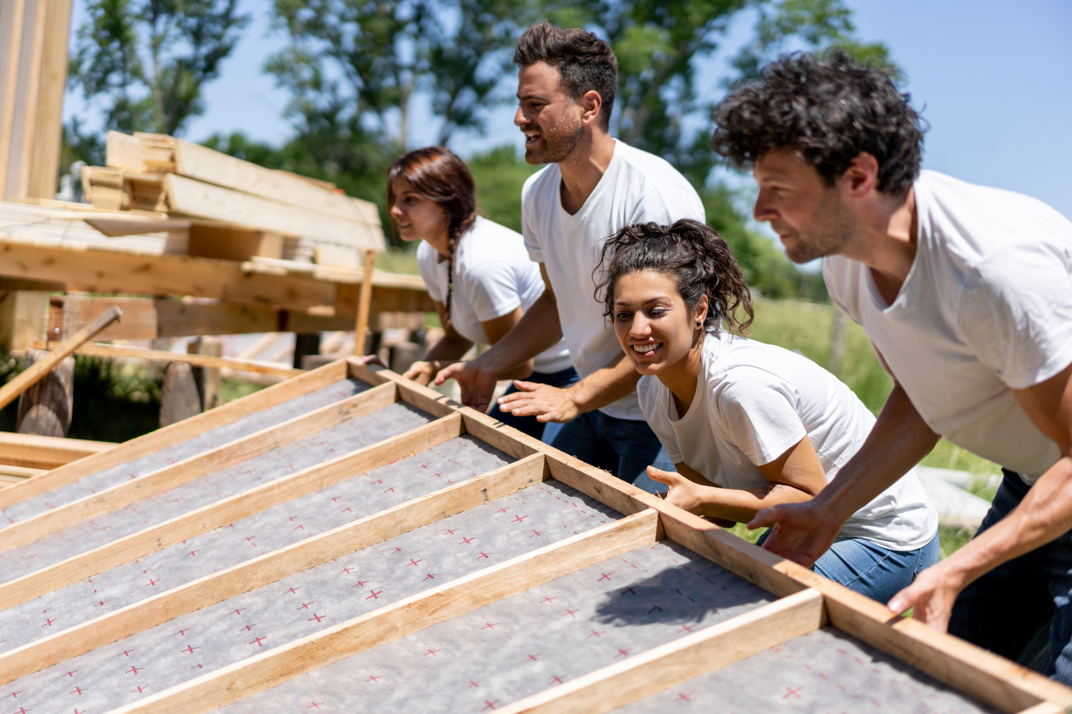 Latin american volunteers working hard at a charity construction project